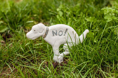 Dog statue prohibiting dogs on the lawn Royalty Free Stock Photography