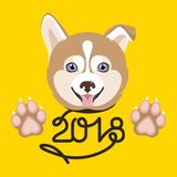 Dog Symbol of the New Year. On a yellow background Royalty Free Stock Images