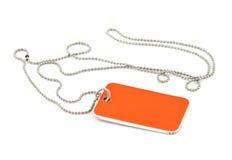 Dog tag. Blank orange dog tag on white background Stock Photos