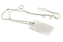 Dog tag. Blank silver dog tag on white background Royalty Free Stock Photography