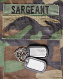 Dog tags. On a uniform with name tag Royalty Free Stock Images