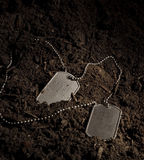 Dog Tags. A photo of military dog tags in the dirt Royalty Free Stock Images