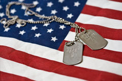 Dog tags on american flag. Pair of dog tags on american flag royalty free stock photos