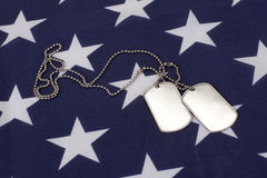 Dog tags on american flag Royalty Free Stock Image