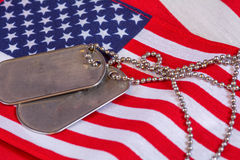 Dog Tags on American flag. Set of blank dog tags on American Flag Stock Photos