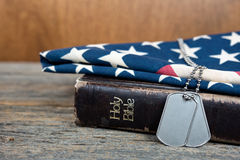 Dog tags on Bible Royalty Free Stock Images