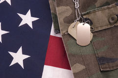 Dog Tags on Flag. Military Dog Tags on American Flag and fatigues Stock Image