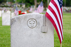 Dog tags on veterans grave Royalty Free Stock Photos