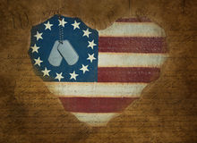 Dog tags on vintage heart flag Royalty Free Stock Photos