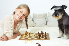 The dog teaches the child to play chess. Your move Royalty Free Stock Image