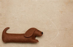 Dog toy on old paper background Stock Photos
