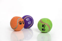 Dog toys. Colorful tennis balls with paw prints, isolated on a white background Stock Photo