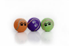 Dog toys. Colorful tennis balls with dog paw prints. on white background royalty free stock photos