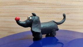Toys dog. Handmade from plasticine Stock Photos