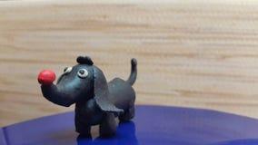 Toys dog. Handmade from plasticine stock photos