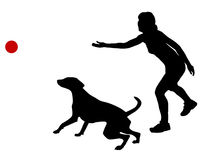 Dog training with ball Stock Images