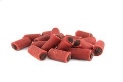 Dog treats. Bits of meaty dog treats on a white background royalty free stock photography