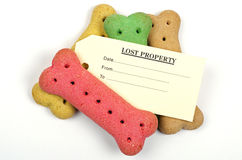 Dog treats and lost property label Stock Photos