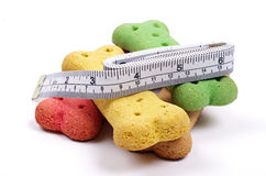 Dog treats and measuring tape Stock Images