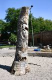 Dog Tree. This is a Summer picture of a piece of public art titled: Dog Tree, part of the Chicago Tree Project using dead Ash Trees in Portage Park located in royalty free stock photography