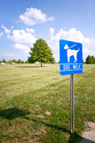 Dog walk sign in the park. With blue sky Stock Image