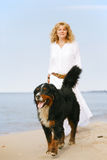 Dog walks with woman Royalty Free Stock Images