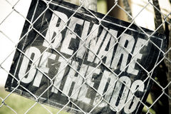 Dog Warning. Beware of the Dog Sign inside a fenced urban area stock images