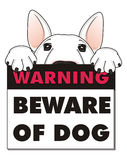 Dog with warning plate Royalty Free Stock Image