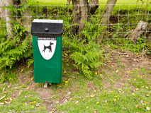 Dog Waste Bin. Green dog waste diposal bin by the side of a public footpath in the countryside Stock Photography