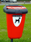 Dog waste bin. Dog waste disposal bin on a wide grass verge in the UK Royalty Free Stock Photos