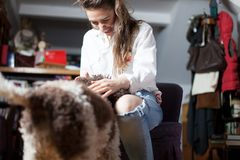 Dog welcomes woman after returning home. Dog welcomes young woman after returning home Stock Images