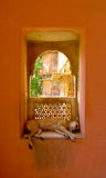 Dog in a window. Stray dog resting on a window in a Bikaner palace, Rajasthan, India Stock Photo