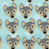 Dog Wolf Seamless pattern with funny cute animal face on a blue Royalty Free Stock Photography