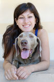 Dog and woman Stock Images