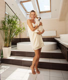 Dog beside the woman in the bathroom Stock Photo
