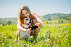 Dog and woman - modern world Royalty Free Stock Photography