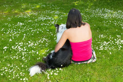 Dog and woman in the park Stock Photos