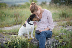 Dog and woman posing outdoor Royalty Free Stock Photography