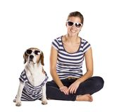 Dog and woman in studio Stock Images