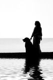 Dog and woman with reflections Royalty Free Stock Photography
