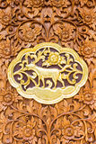 Dog wood Carving Wall sculptures in thai temple Royalty Free Stock Images