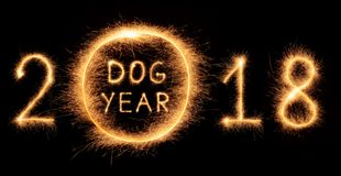 2018 DOG YEAR lettering drawn with bengali sparkles Stock Images
