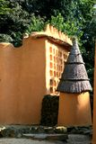 Dogan family and storehouse (Mali). Houses like these are built by the Dogon, a tribe at Mali. At the background a family house. In front of it a round store Royalty Free Stock Photography