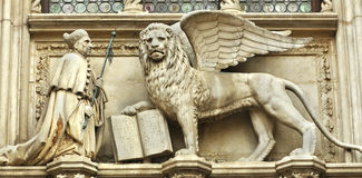 The Doge and the Lion. The doge of Venice kneels before the winged lion of Saint Mark, at the Doge's Palace stock photo