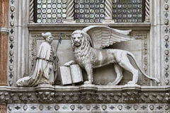 Doge And Lion Venice. Public middle ages sculpture in St. Marks Square on the Doge palace facade stock images