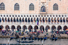Doge palace with gondolas in Venice, Italy Royalty Free Stock Image