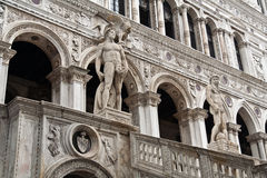 The Doge Palace Venice. Two male statues at the inner square of the Doge Palace. Venice, Italy royalty free stock images