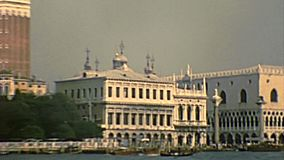Archival Venice Doge Palace by sea. Doge`s Palace in San Marco square of Venice with the bell tower and Marciana National Library. Sea view by boat tour stock video footage