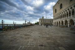 The doge`s palace on the st marks square in venice on a dark clo. The Palazzo Ducale on the piazza San Marco in venice on a dark cloudy day Royalty Free Stock Photography