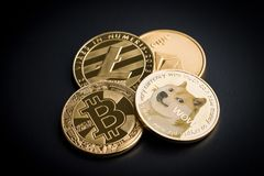 Dogecoin, litecoin, etheteum and bitcoin. Stock Photo